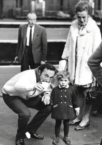 Alvin on set with his wife and little girl